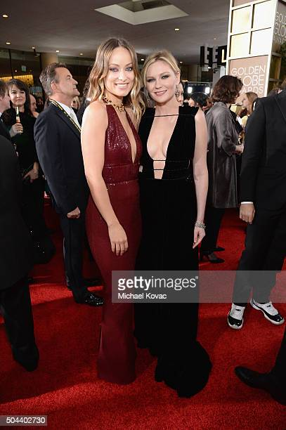 Olivia Wilde and Kirsten Dunst attend the 73rd Annual Golden Globe Awards held at the Beverly Hilton Hotel on January 10 2016 in Beverly Hills...