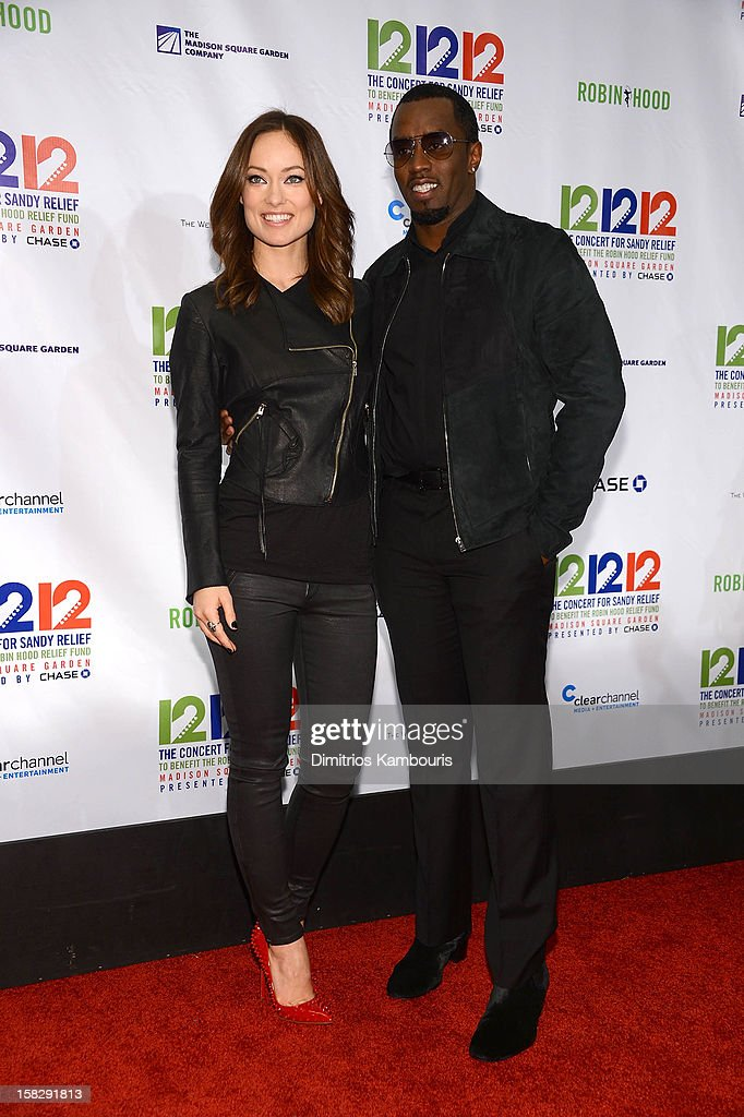 Olivia Wilde and Sean John Combs attend '12-12-12' a concert benefiting The Robin Hood Relief Fund to aid the victims of Hurricane Sandy presented by Clear Channel Media & Entertainment, The Madison Square Garden Company and The Weinstein Company at Madison Square Garden on December 12, 2012 in New York City.