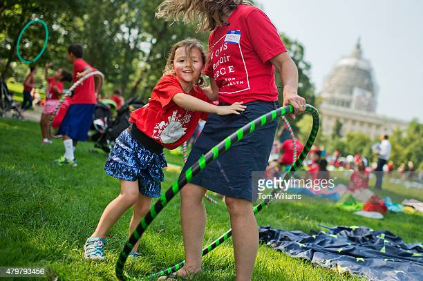 Olivia Yost of Pittsburgh hugs her mother Cyrstal during a playin protest by kids and mothers in Upper Senate Park organized by Moms Clean Air Force...