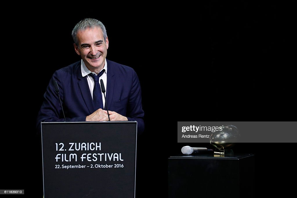 Olivier Assayas gives his acceptance speech after receiving the 'Tribute to...' award on stage during the Award Night Ceremony during the 12th Zurich Film Festival on October 1, 2016 in Zurich, Switzerland. The Zurich Film Festival 2016 will take place from September 22 until October 2.