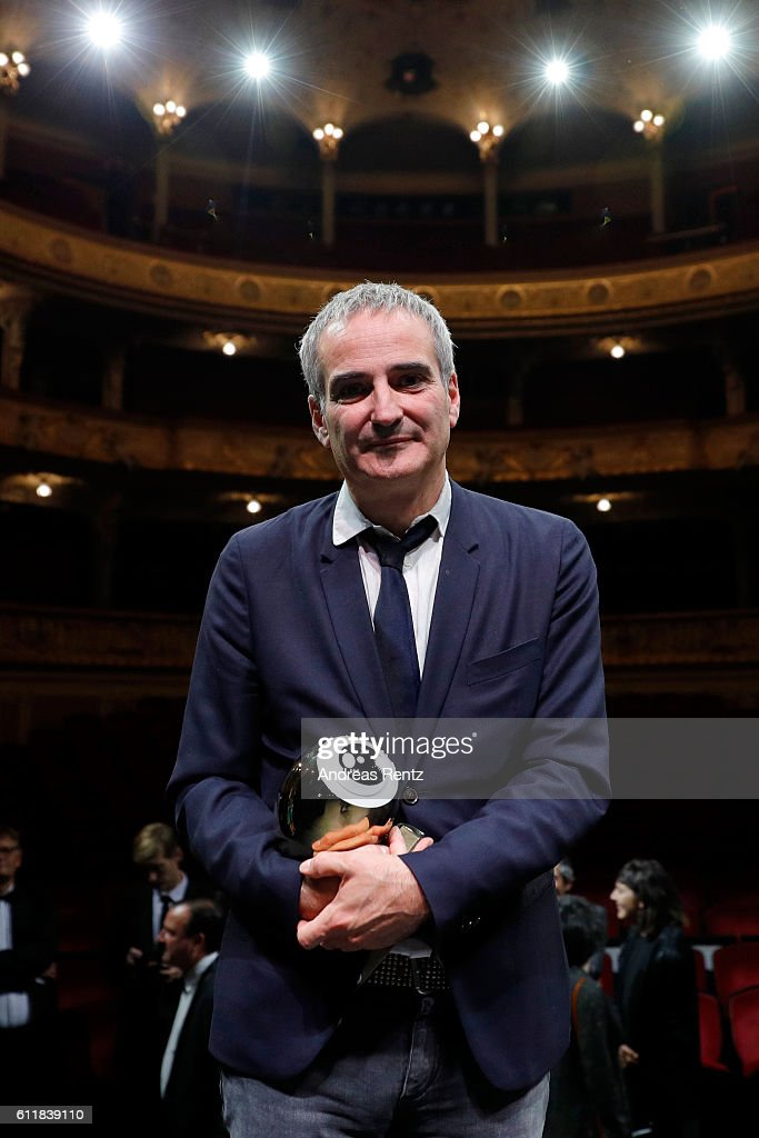 Olivier Assayas poses with his 'Tribute to...' award on stage during the Award Night Ceremony during the 12th Zurich Film Festival on October 1, 2016 in Zurich, Switzerland. The Zurich Film Festival 2016 will take place from September 22 until October 2.