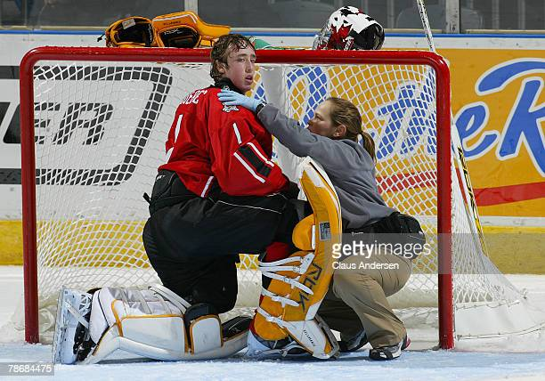 Olivier BellavanceRoy of Team Quebec is attended to after being knocked down during a game against Team Ontario on December 31 2007 at the John...