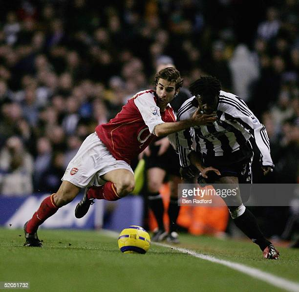 Olivier Bernard of Newcastle and Mathieu Flamini of Arsenal battle for the ball during the Barclays Premiership match between Arsenal and Newcastle...