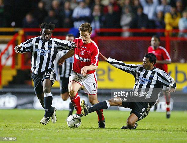 Olivier Bernard of Newcastle and Nolberto Solano tackle Scott Parker of Charlton during the FA Barclaycard Premiership match between Charlton...