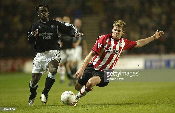 Olivier Bernard of Newcastle is tackled by James Beattie of Southampton during the FA Cup Third Round match between Southampton and Newcastle United...
