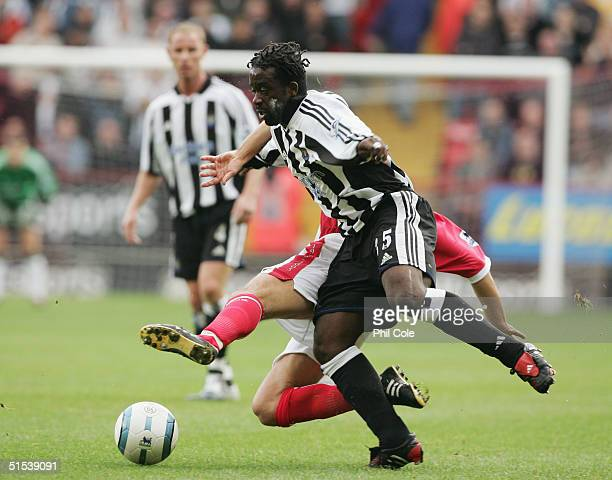 Olivier Bernard of Newcastle United evades Luke Young of Charlton Athletic during the Barclays Premiership match between Charlton Athletic and...