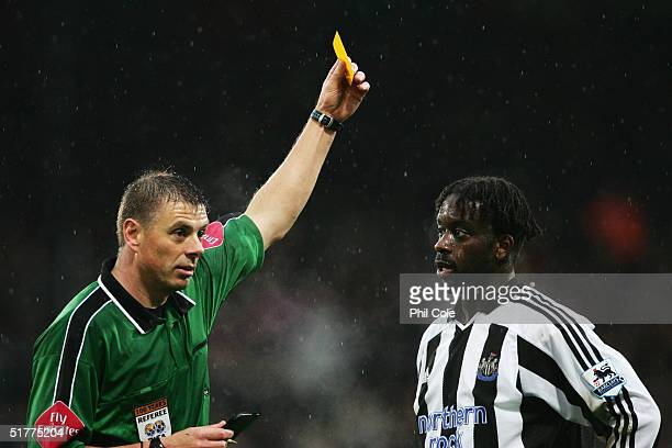 Olivier Bernard of Newcastle United is booked by referee Mark Halsey during the Barclays Premiership match between Crystal Palace and Newcastle...