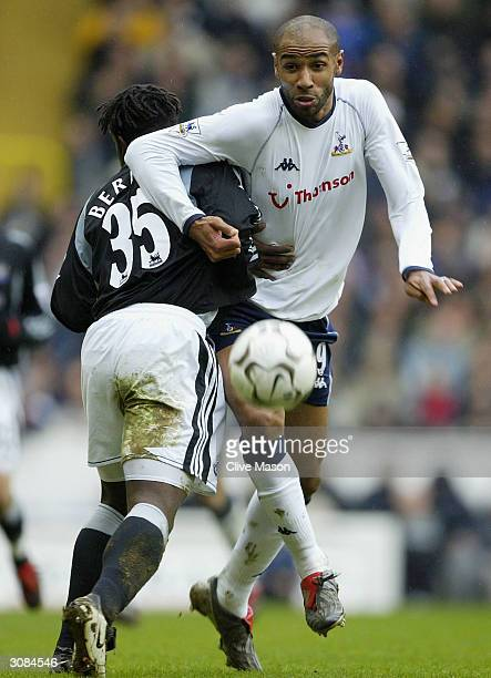 Olivier Bernard of Newcastle United tries to tackle Frederic Kanoute of Tottenham Hotspur during the FA Barclaycard Premiership match between...