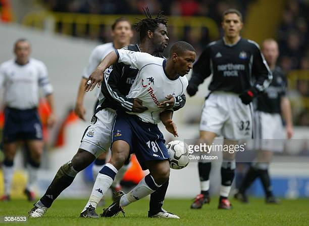 Olivier Bernard of Newcastle United tries to tackle Jermain Defoe of Tottenham Hotspur during the FA Barclaycard Premiership match between Tottenham...