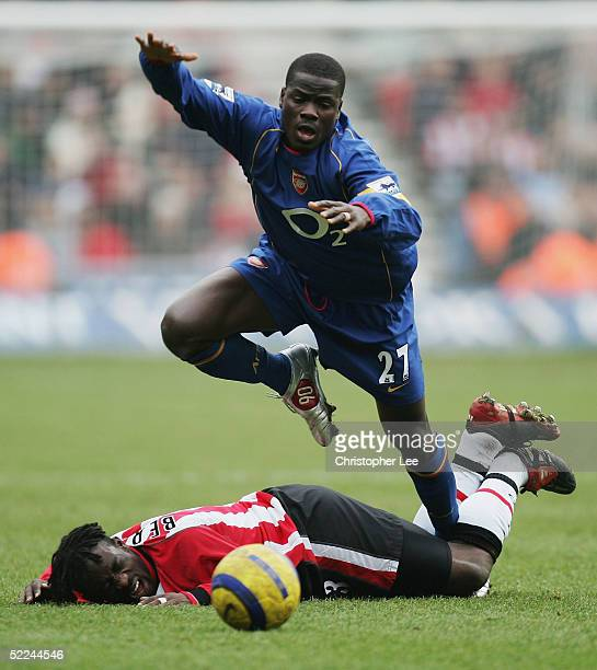 Olivier Bernard of Southampton tackles Emmanuel Ebque of Arsenal during the Barclays Premiership match between Southampton and Arsenal at St Marys...