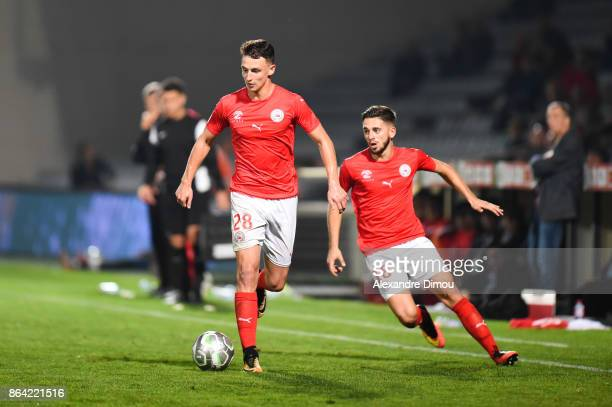 Olivier Boscagli and Theo Valls of Nimes during the Ligue 2 match between Nimes Olympique and Stade Brestois at on October 20 2017 in Nimes France