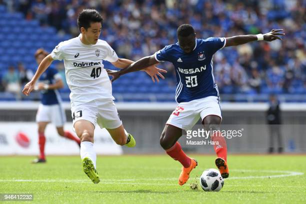 Olivier Boumal of Yokohama FMarinos and Yuki Kobayashi of Vissel Kobe compete for the ball during the JLeague J1 match between Yokohama FMarinos and...