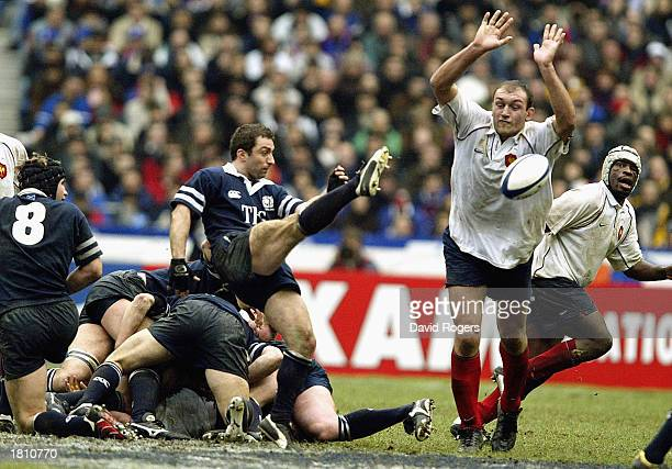 Olivier Brouzet of France charges down a kick from Bryan Redpath of Scotland during the RBS Six Nations match between France and Scotland at the...