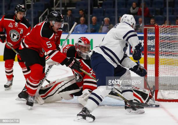 Olivier Chalifour of the Quebec Remparts makes a save on Alexis Lafreniere the Rimouski Oceanic during the third period of their QMJHL hockey game at...