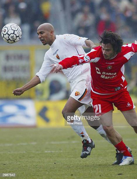 Olivier Dacourt of Roma challenges Corrado Grabbi of Ancona in action during the Serie A match Between Ancona and Roma at the Del Conero stadium on...