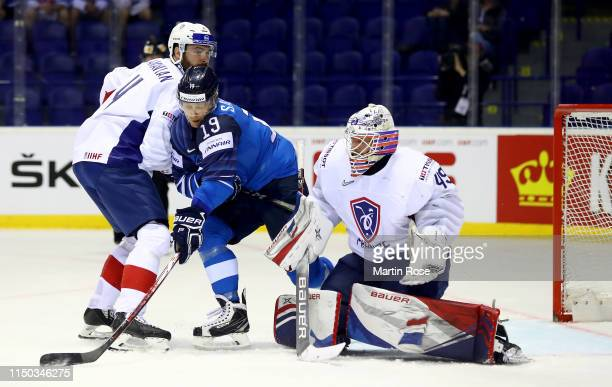 Olivier Dame Malka of France challenges Veli Matti Savinainen of Finland during the 2019 IIHF Ice Hockey World Championship Slovakia group A game...