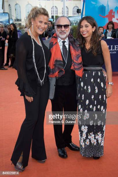 Olivier Dassault poses with his wife Natacha Nikolajevic and daughter Helena as they arrive at the closing ceremony of the 43rd Deauville American...