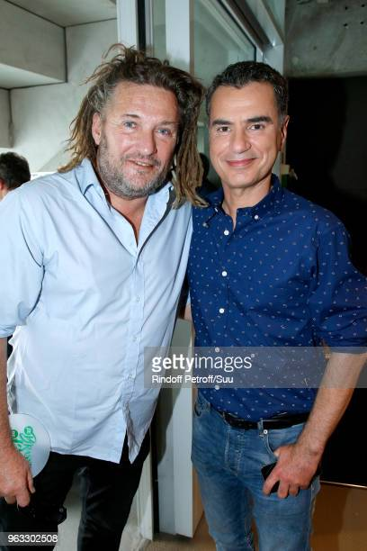 Olivier Delacroix and Sports Journalist Laurent Luyat pose at France Television french chanel studio during the 2018 French Open Day Two at Roland...