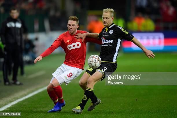 Olivier Deschacht defender of Lokeren holds off the challenge of Renaud Emond forward of Standard Liege during the Jupiler Pro League match between...