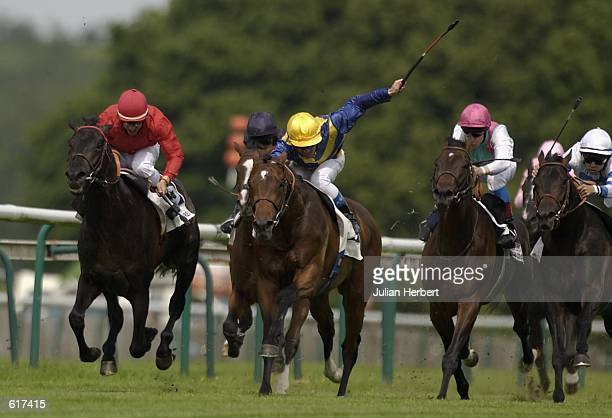 Olivier Doleuze and Rouvres come through the field to land The Prix Jean Prat run at Chantilly Racecourse in Chantilly near Paris France on June 2...