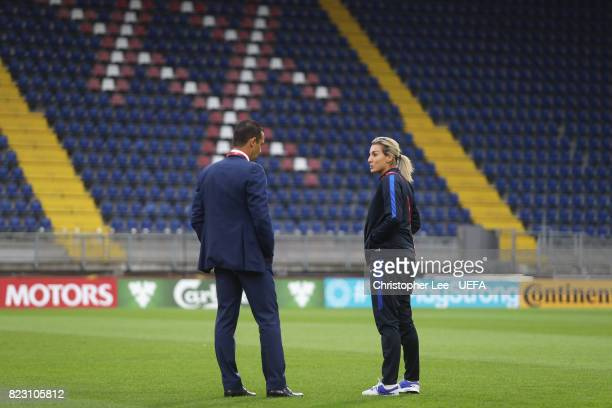 Olivier Echouafni head coach of France talks to Amandine Henry of France before the match during the UEFA Women's Euro 2017 Group C match between...