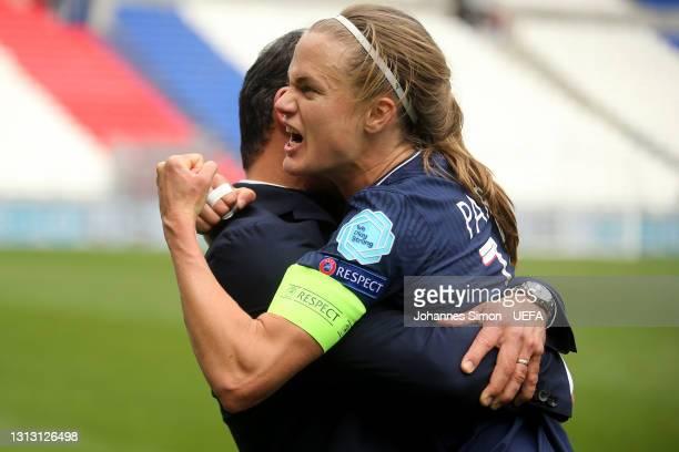 Olivier Echouafni, Head Coach of Paris Saint-Germain and Irene Paredes of Paris Saint-Germain celebrate following their team's victory in the Second...