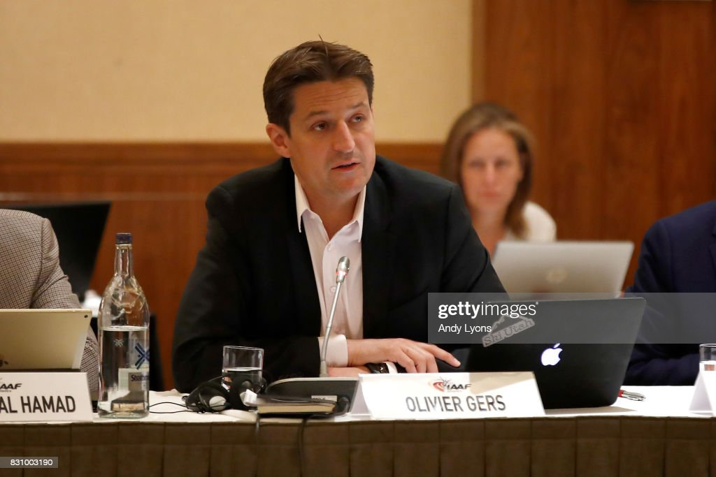 Olivier Gers, CEO of the IAAF, talks with to the council members during the 211th IAAF Council Meeting on August 13, 2017 in London, England.