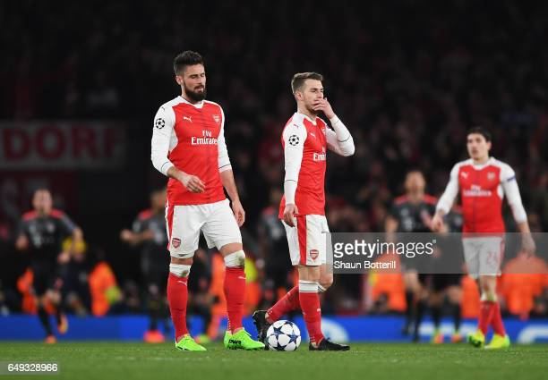 Olivier Giroud and Aaron Ramsey of Arsenal look dejected during the UEFA Champions League Round of 16 second leg match between Arsenal FC and FC...