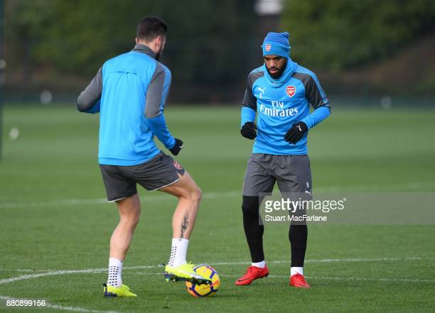 Olivier Giroud and Alex Lacazette of Arsenal during a training session at London Colney on November 28 2017 in St Albans England
