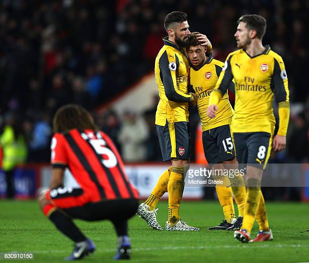 Olivier Giroud and Alex OxladeChamberlain of Arsenal embrace at the final whistle during the Premier League match between AFC Bournemouth and Arsenal...