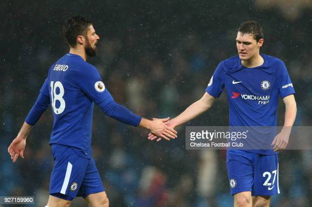 Olivier Giroud and Andreas Christensen of Chelsea shake hands following the Premier League match between Manchester City and Chelsea at Etihad...