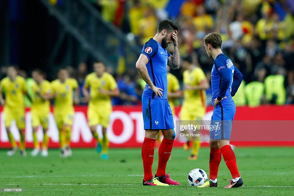 Olivier Giroud (L) and Antoine Griezmann (R) of France react after Romania's first goal during the UEFA Euro 2016 Group A match between France and Romania at Stade de France on June 10, 2016 in Paris, France.