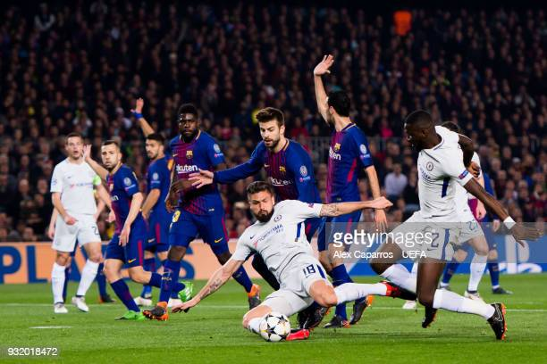 Olivier Giroud and Antonio Rudiger of Chelsea FC try to reach the ball during the UEFA Champions League Round of 16 Second Leg match between FC...