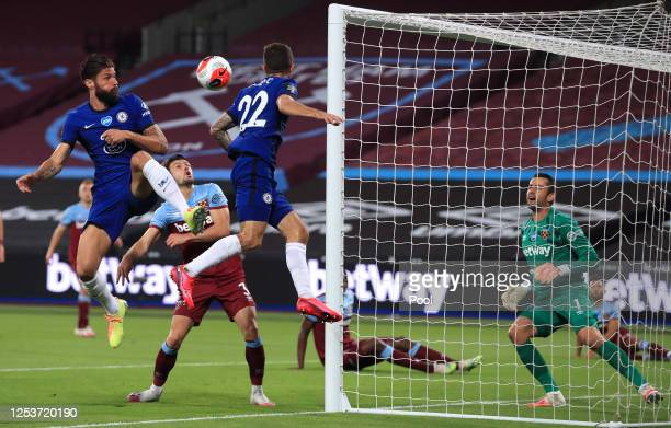 Olivier Giroud and Christian Pulisic of Chelsea battle for the ball with Aaron Cresswell of West Ham United during the Premier League match between...