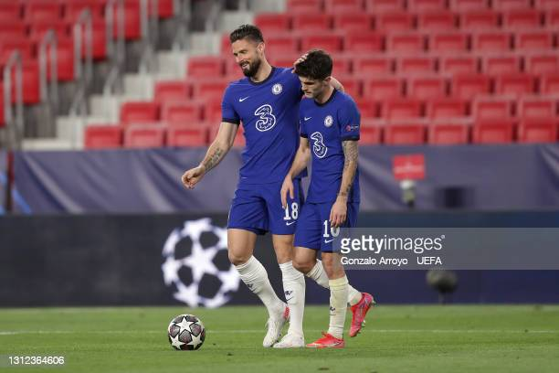 Olivier Giroud and Christian Pulisic of Chelsea celebrate following victory during the UEFA Champions League Quarter Final Second Leg match between...