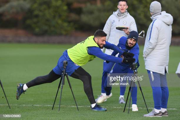 Olivier Giroud and Davide Zappacosta of Chelsea during a training session at Chelsea Training Ground on December 7, 2018 in Cobham, England.
