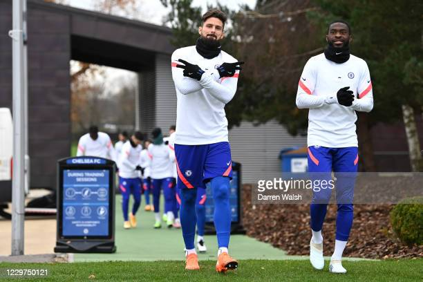 Olivier Giroud and Fikayo Tomori of Chelsea before a training session ahead of the UEFA Champions League Group E stage match between Chelsea FC and...