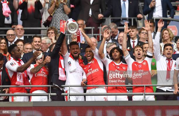 Olivier Giroud and Francis Coquelin of Arsenal lift the FA Cup Trophy after the match between Arsenal and Chelsea at Wembley Stadium on May 27 2017...