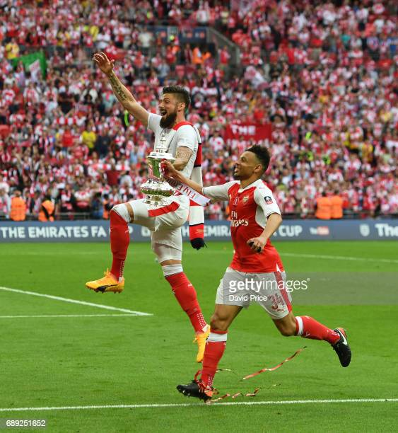 Olivier Giroud and Francis Coquelin of Arsenal with the FA Cup Trophy after the match between Arsenal and Chelsea at Wembley Stadium on May 27 2017...