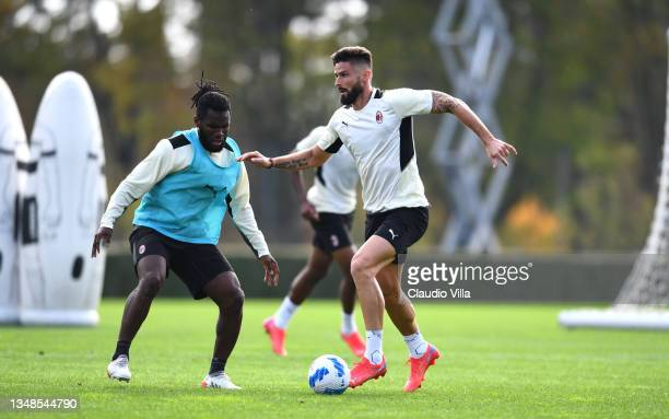 Olivier Giroud and Franck Kessie of AC Milan in action during an AC Milan training session at Milanello on October 24, 2021 in Cairate, Italy.