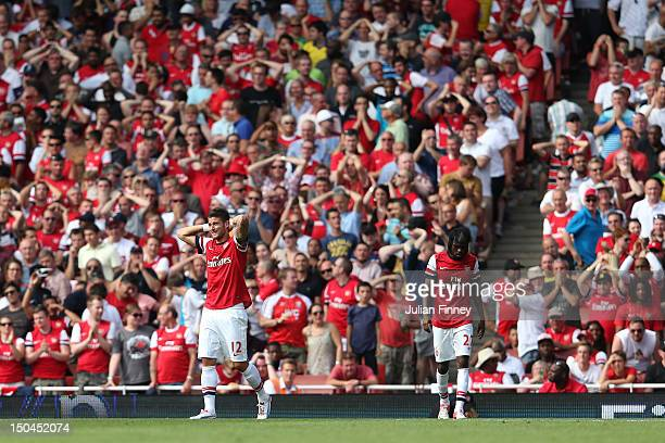 Olivier Giroud and Gervinho of Arsenal react to a play during the Barclays Premier League match between Arsenal and Sunderland at Emirates Stadium on...