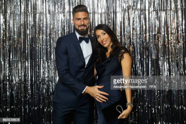 Olivier Giroud and his wife Jennifer Giroud are pictured inside the photo booth prior to The Best FIFA Football Awards at The London Palladium on...