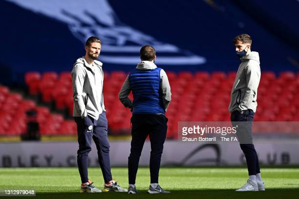 Olivier Giroud and Kai Havertz of Chelsea speak during a pitch inspection prior to the Semi Final of the Emirates FA Cup match between Manchester...