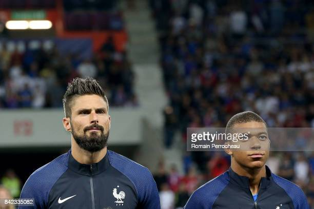 Olivier Giroud and Kylian Mbappe of France look on beofre the FIFA 2018 World Cup Qualifier between France and Luxembourg at Stadium on September 3...