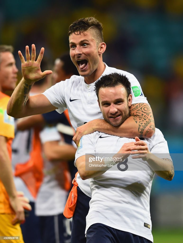 Olivier Giroud and Mathieu Valbuena of France celebrate after defeating Switzerland 5-2 during the 2014 FIFA World Cup Brazil Group E match between Switzerland and France at Arena Fonte Nova on June 20, 2014 in Salvador, Brazil.