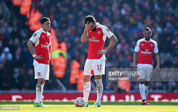 Olivier Giroud and Mesut Ozil of Arsenal look dejected as Adlene Guedioura of Watford scores their second goal during the Emirates FA Cup sixth round...