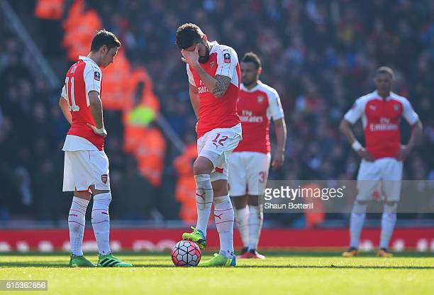 Olivier Giroud and Mesut Ozil of Arsenal look dejected as Odion Ighalo of Watford scores their first goal during the Emirates FA Cup sixth round...