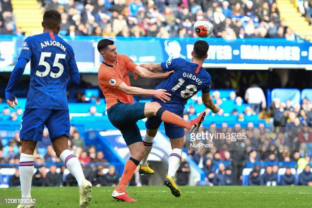 Olivier Giroud and Michael Keane during the Premier League match between Chelsea and Everton at Stamford Bridge London on Sunday 8th March 2020