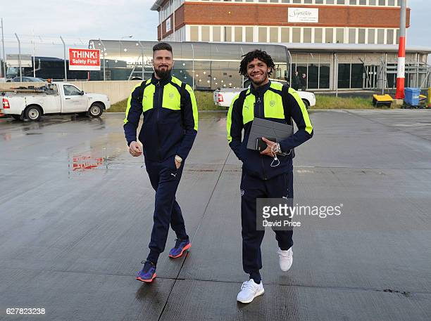 Olivier Giroud and Mohamed Elneny of Arsenal boards the plane at Luton Airport on December 5 2016 in Luton England