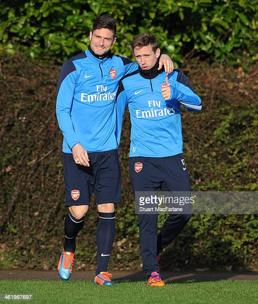 Olivier Giroud and Nacho Monreal of Arsenal before a training session at London Colney on January 12 2014 in St Albans England